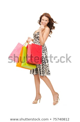 Satisfied lady shopper with shopping bag Stock photo © stockyimages