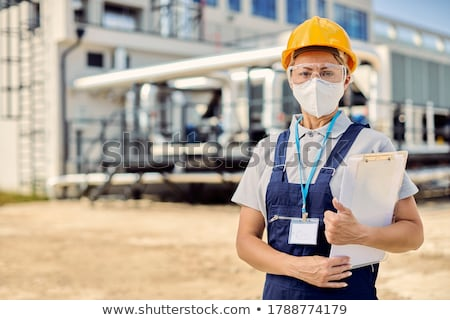A female foreman with a clipboard. Stock photo © photography33