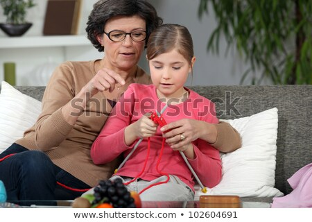 grandmother teaching granddaughter how to knit Stock photo © photography33