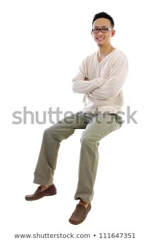 Asian Man Sitting On Transparent Chair Foto d'archivio © szefei