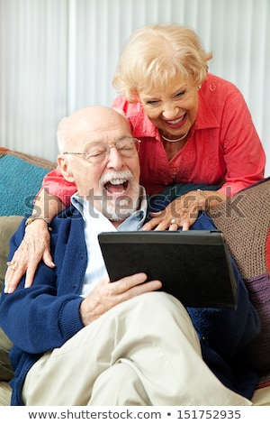 couple on the couch having fun on their computers Stock photo © photography33