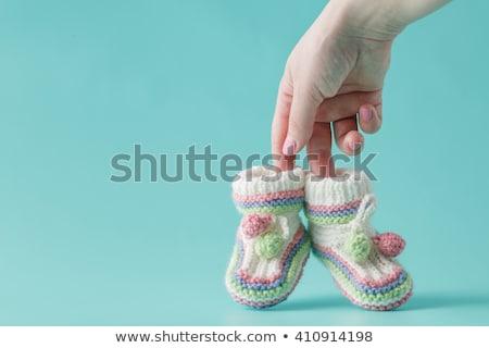 anyuka · gyönyörű · terhes · nő · tart · kicsi · babacipők - stock fotó © dash