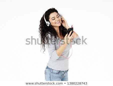 cheerful teen girl listening music lying on a sofa stock photo © wavebreak_media