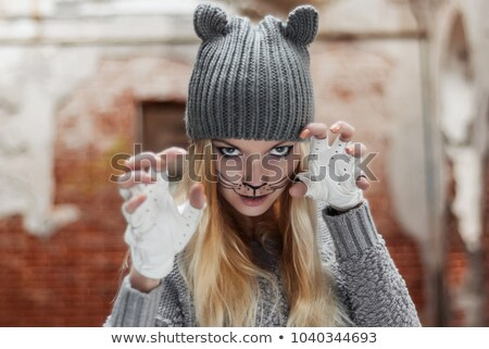 Portrait of attractive girl in gloves with claws stock photo © acidgrey