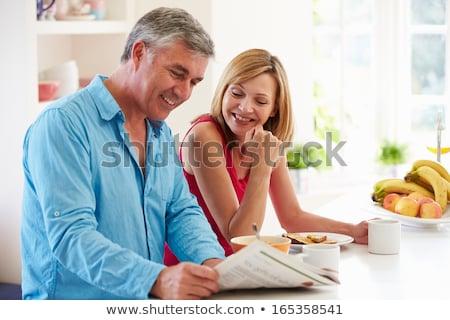 boldog · pár · olvas · újság · konyha · reggeli - stock fotó © wavebreak_media