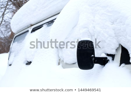 Stok fotoğraf: Car Wheel Stuck In A Snow Blizzard
