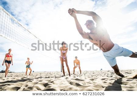 Praia vôlei com esportes mar azul Foto stock © dinozzaver