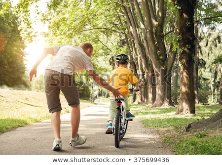Father and his son playing outside Stock photo © emese73