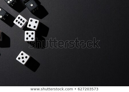 Poker game dices over black table Stock photo © lunamarina