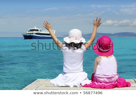 two girls tourist turquoise sea goodbye hand gesture stock photo © lunamarina