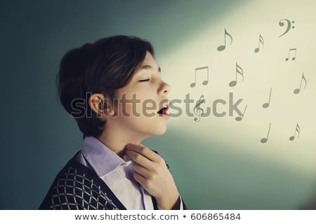 close up of boy singing stock photo © zzve