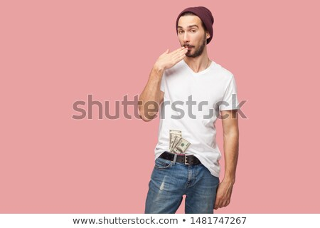 crooked casual man with hands in pockets Stock photo © feedough