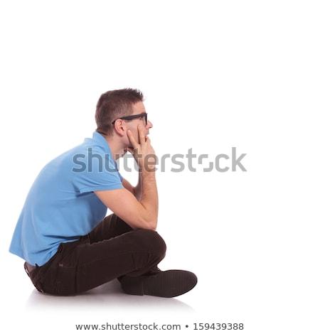 Lato casuale uomo seduta gambe incrociate vista laterale Foto d'archivio © feedough