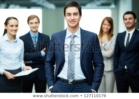 friendly business people with male leader in front stock photo © stockyimages