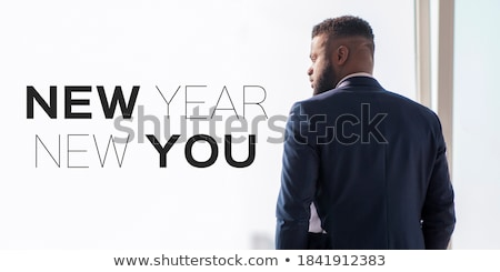 Young businessman standing on office  Stock photo © nenetus