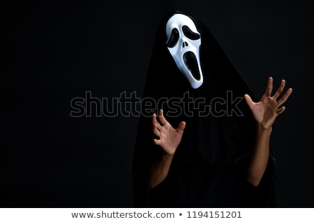 man in devil costume in halloween concept stock photo © elnur