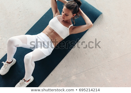 Fit woman doing stretching exercises, on white Stock photo © stryjek