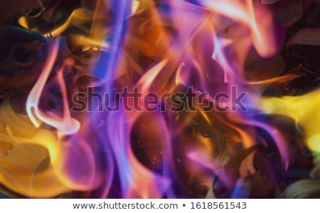 Glowing ember with blue flames Stock photo © creisinger