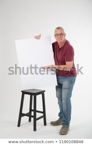 smiling casual old man holding a big blank board stock photo © feedough