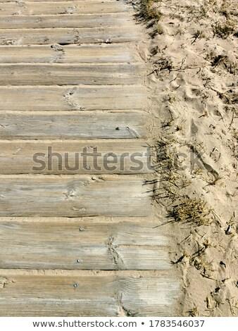 Vintage wooden fence on sandy beach Stock photo © stevanovicigor