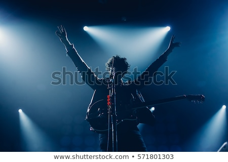 rock star singing on stage stock photo © stokkete