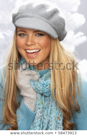 Fashionable Young Woman Wearing Cap And Knitwear In Studio Stock photo © monkey_business
