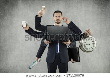 бизнесмен занят изолированный четыре Сток-фото © dgilder