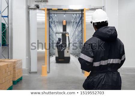 Worker in a storage room on a factory  Stock photo © Nejron
