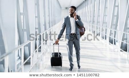 man airport suitcase stock photo © hasloo