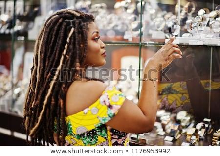 Young girl deciding what jewellery to wear Stock photo © stryjek