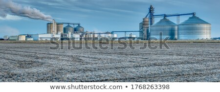 Tractor blending in a rural landscape Stock photo © Smileus