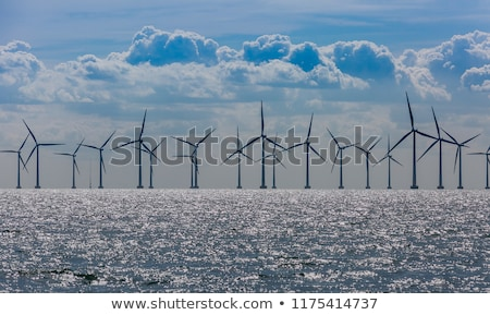 Zöld mező part szélturbinák tájkép kék Stock fotó © olandsfokus