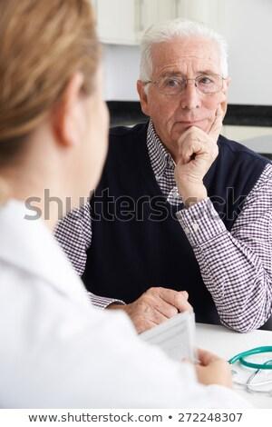 старший человека заседание врач хирургии Сток-фото © HighwayStarz