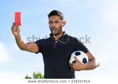 Referee Blowing Whistle With Rugby In Hand Stock photo © AndreyPopov
