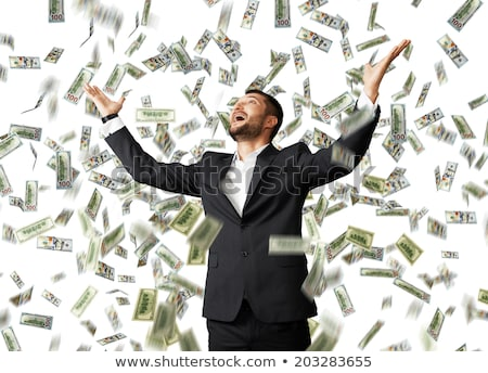 Happy businessman raising hands up and looking up under money rain Stock photo © deandrobot