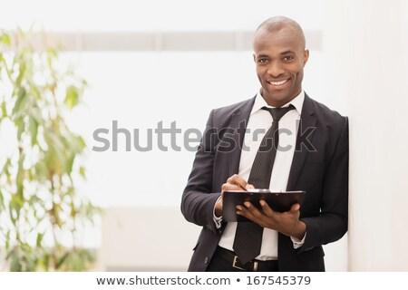 business man leaning on something stock photo © fuzzbones0