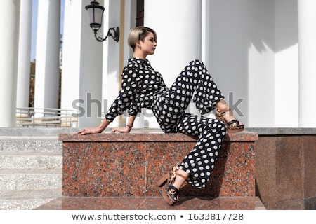 Beautiful girl in black gymnastic suit Stock photo © Aikon