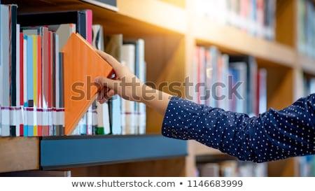 Kéz elvesz könyv könyvespolc könyvtár nő Stock fotó © wavebreak_media