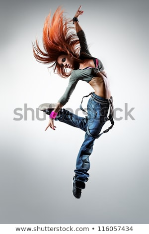 female hip hop dancer jumping in the air stock photo © stryjek