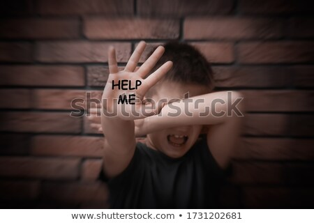 Scared boy with horror text Stock photo © Dashikka
