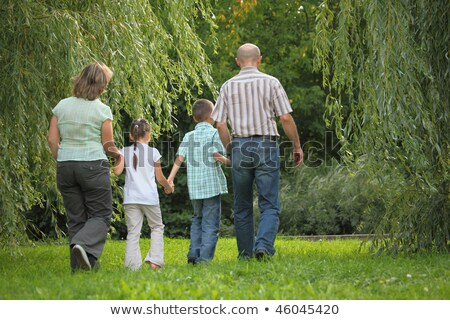family with two children in early fall park father mother little boy and girl stock photo © paha_l