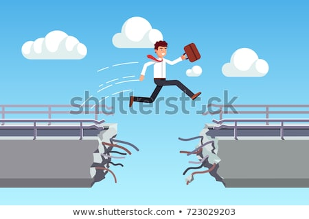 Energetic business man jumping over a bridge with gap Stock photo © ra2studio