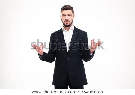 Handsome businessman in black suit holding copyspace on both palms  Stock photo © deandrobot