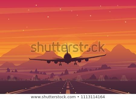 Sol vuelo avión montanas nubes cielo Foto stock © mayboro1964