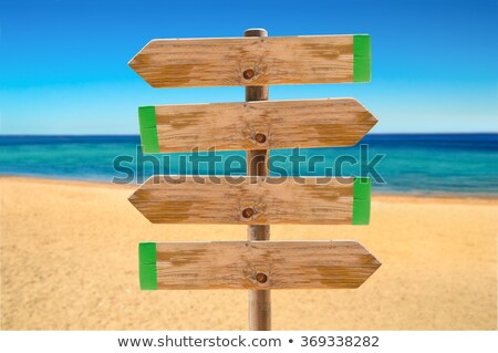 Fából készült irányítás felirat copy space tengerparti homok felső Stock fotó © stevanovicigor