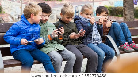 Young tween boy chatting on a mobile phone Stock photo © ozgur