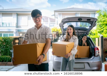 a boy carrying a box stock photo © bluering