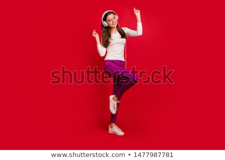 Trendy young woman listening to Christmas music Stock photo © dash