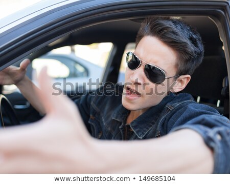 Rude driver cursing Stock photo © szefei