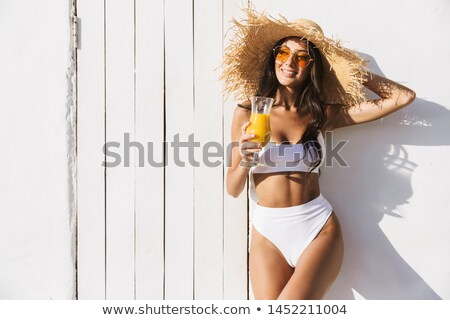 Portrait of a young, alluring woman on a beach Stock photo © konradbak